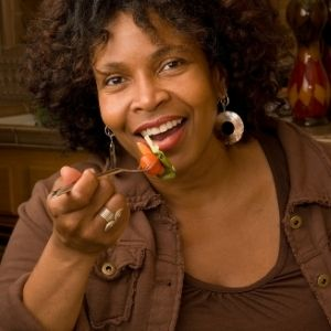 Black woman eating salad